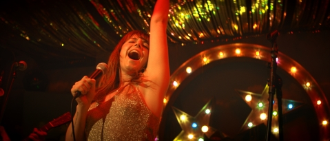 Rose-Lynn Harlan (Jessie Buckley) in WILD ROSE. Courtesy of NEON.